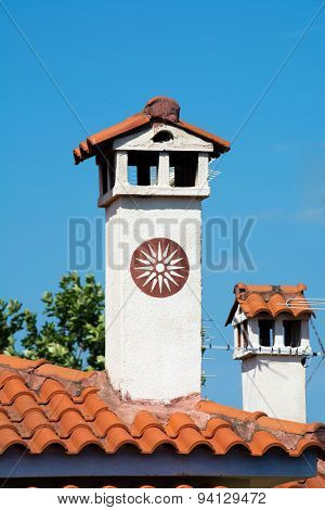 Chimneys on typical Greek roofs
