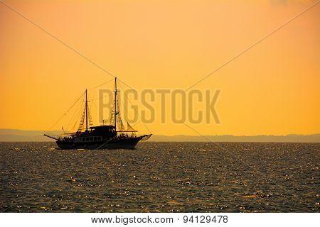 Touristic ship on the sea at sunset