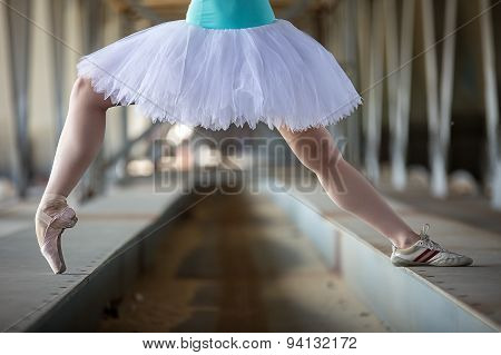 Cropped picture legs of graceful ballerina in white tutu