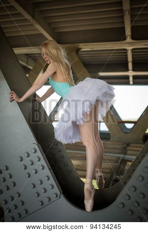 Graceful ballerina in the industrial background