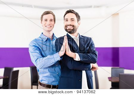 Gay couple in dance class learning