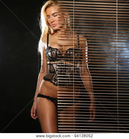 young sexy woman in black lingerie