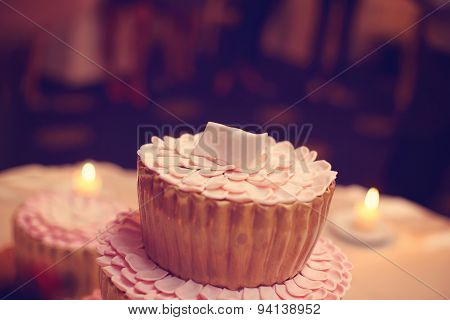 Small Delicious Cake With Candles In The Background