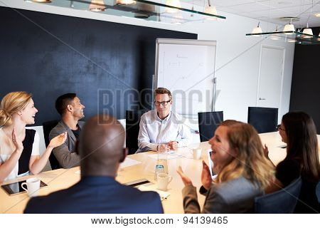 Group Of Executives Applauding White Male Executive