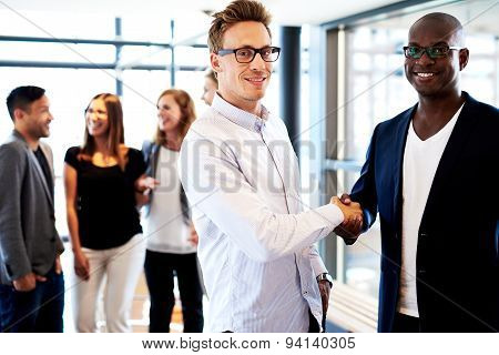 Black Man And White Man Shaking Hands