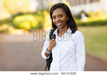 pretty female african college student with backpack on campus