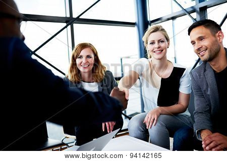 White Female Executive Smiling At Camera