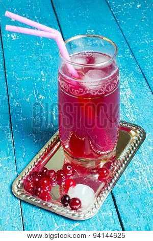 A Glass Of Freshly Made Drink With Cranberry Juice And Ice
