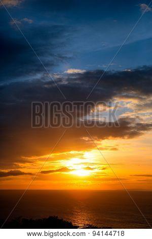 tropical beach sunset with beautiful orange sunlight