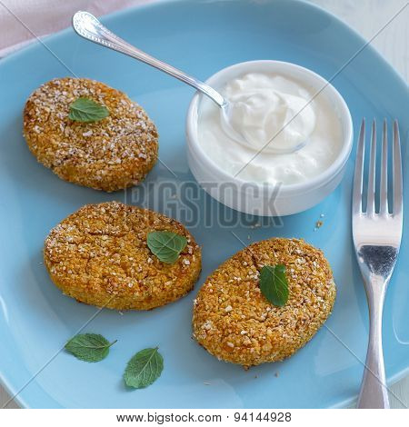 Healthy vegetable cutlets with carrot, dried apricots, almonds and herbs