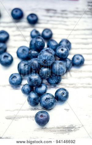 Freeh blueberry  on wooden background, top view