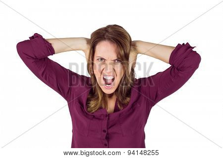 Pretty brunette shouting with hands on head on white background