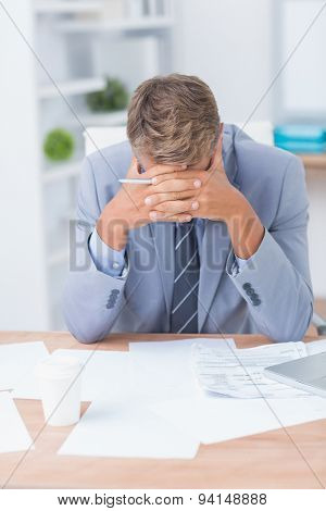 Businessman being depressed by working in office