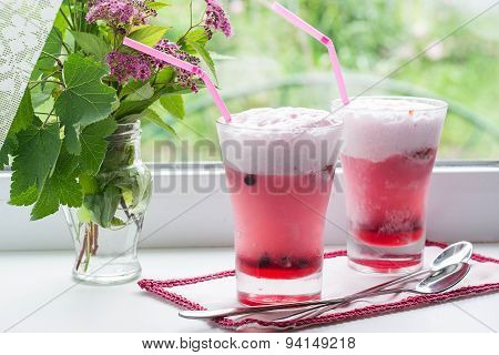 Fruit Cocktail With Ice Cream And Flowers On The Window