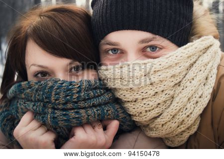 Winter outdoor portrait of young pair, in the winter forest