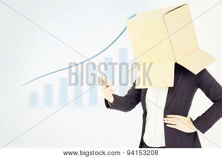 Anonymous businesswoman with her hands up against blue bar chart with blue arrow