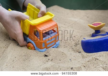 Playing A Toy Truck