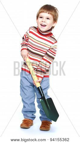 little boy with a shovel in his hands