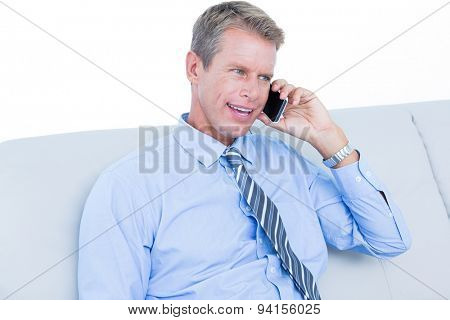 Thoughtful businessman calling on the phone