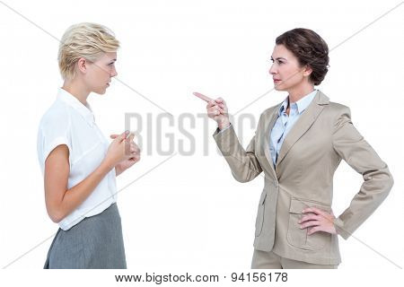 Businesswomen having a violent debate in office against a white screen