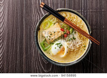 Asian Miso Ramen Noodles With Egg, Tofu And Enoki In Bowl On Gray Wooden Background