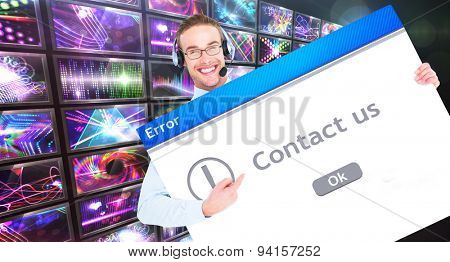 Businessman showing card wearing headset against contact us