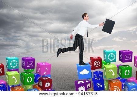 Businessman walking with his briefcase against desert landscape