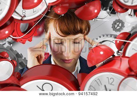 Stressed businesswoman against grey vignette