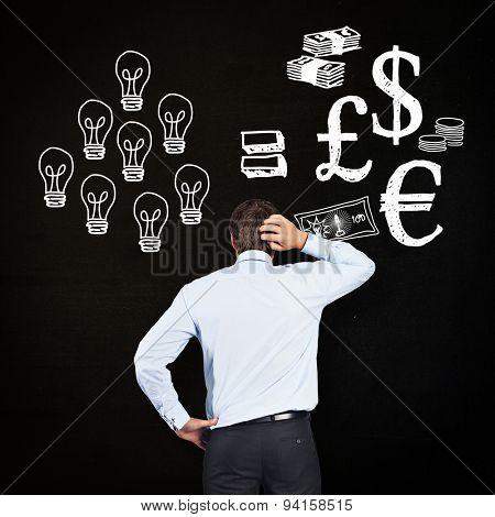 Thinking businessman scratching head against black