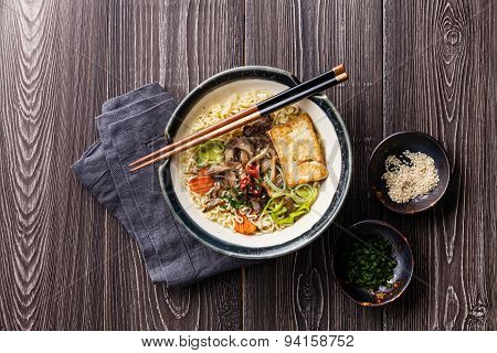 Asian Noodles With Tofu, Oyster Mushrooms And Vegetables In Bowl On Gray Wooden Background