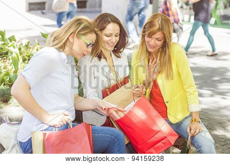 Happy Shopping Female Friends Buying Outdoor