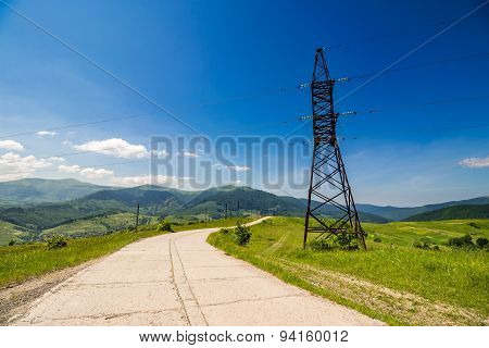 High Voltage Power Lines Tower In Mountains