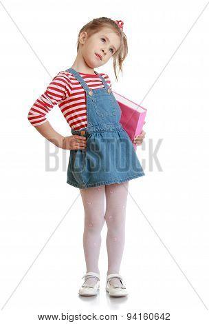 Beautiful little girl in a short denim