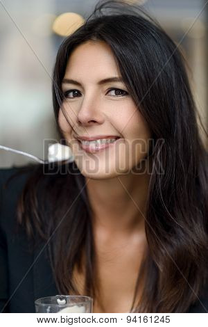 Smiling Woman Enjoying Her Cup Of Cappuccino