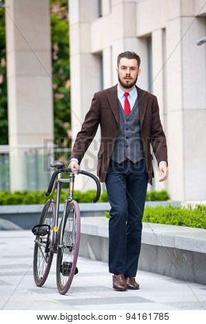 Handsome businessman and his bicycle