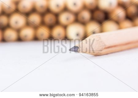 Close up of pencils with different color over white background.