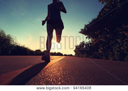 young fitness woman running on sunrise seaside trailvintage effect