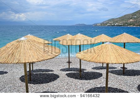 Sun Umbrellas On The Beach In Loutraki.