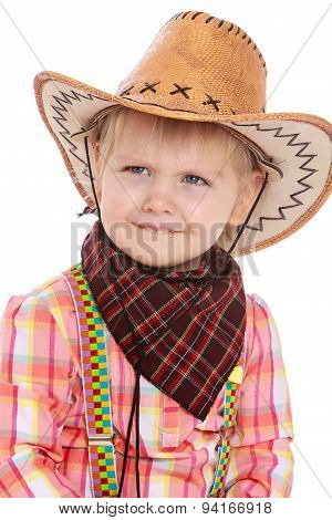 Smiling little girl in cowboy costume
