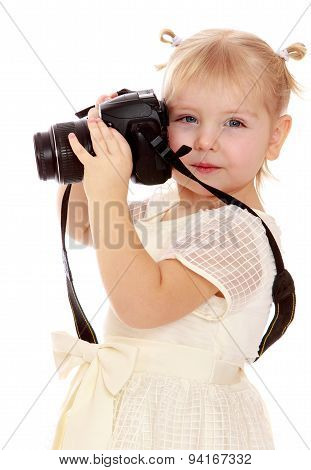 little girl with a camera in hand