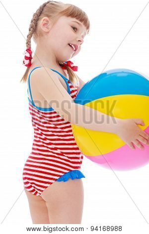 Girl in a swimsuit on the beach