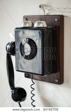 Vintage Black Wired Phone On The Wall