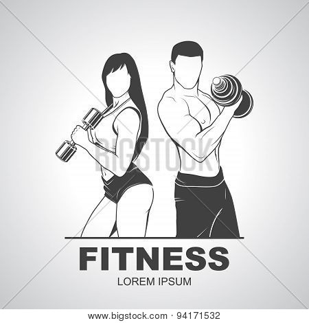 Beautiful fitness young sporty couple with dumbbells.