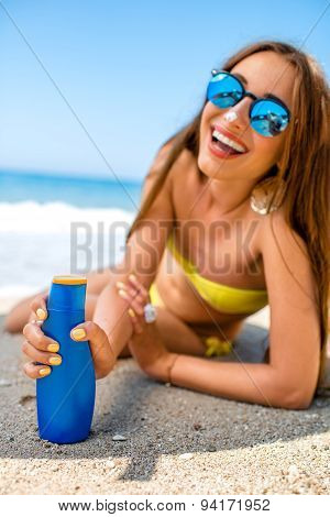 Woman advertising suntan cream