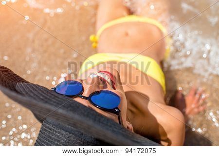 Woman engoying sun and water on the beach