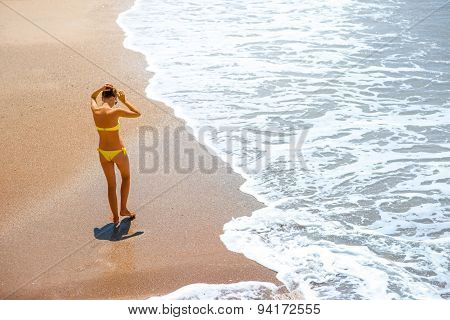 Woman walking on the sea coast