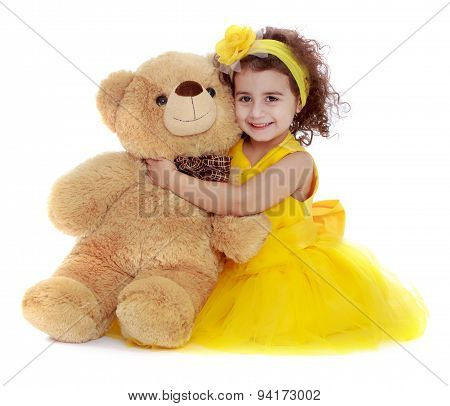 Portrait of beautiful girl 4 years which hugs a Teddy bear