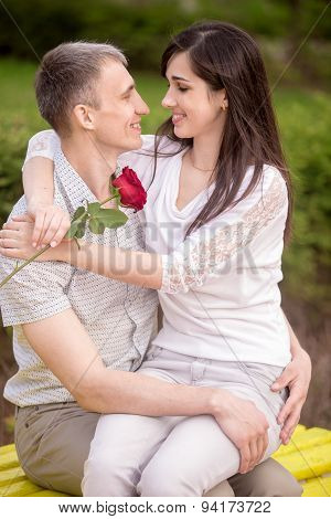 Couple Embracing On Bench