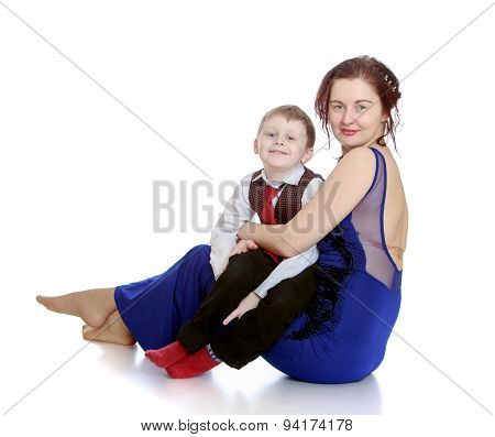 Stylish young mother holding her beloved son