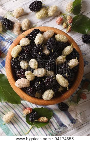 White And Black Mulberries In Bowl Close-up. Vertical Top View
